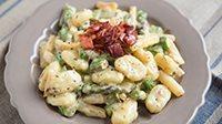 Gnocchi di miglio con asparagi e pancetta-1